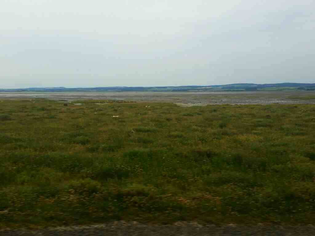 Looking across to the mainland from a 477 bus on Lindisfarne Causeway Holy Island