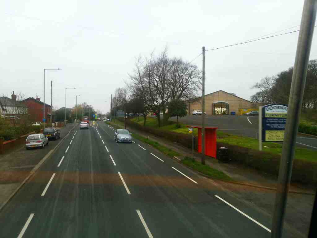 Heading into Whittle le Woods along Preston Rd the A6 on a 125 bus
