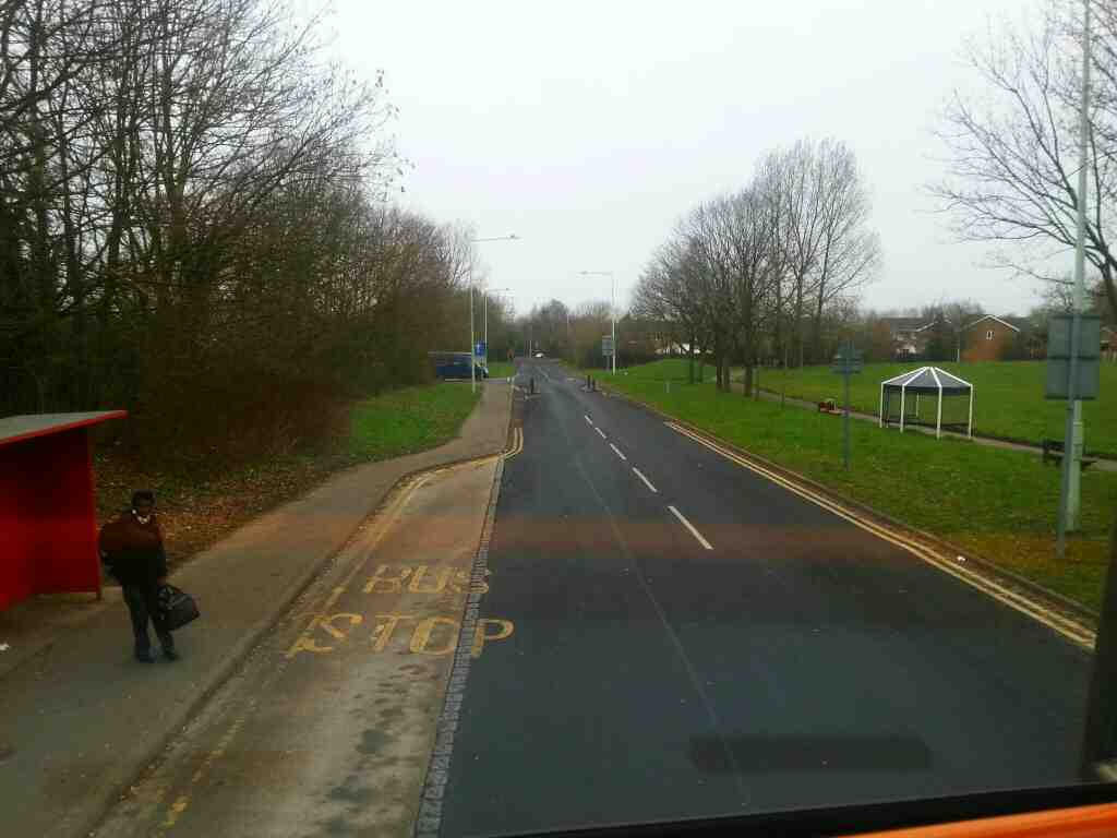 Junction of Great Greens Lane and School Field on a 125 bus