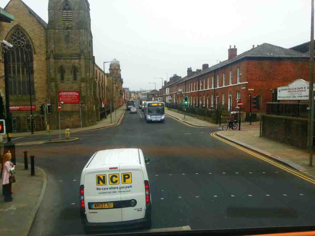 Junction of St George's Rd and Knowsley St Bolton the united reform church of St Andrew and St George Bolton from a 125 bus