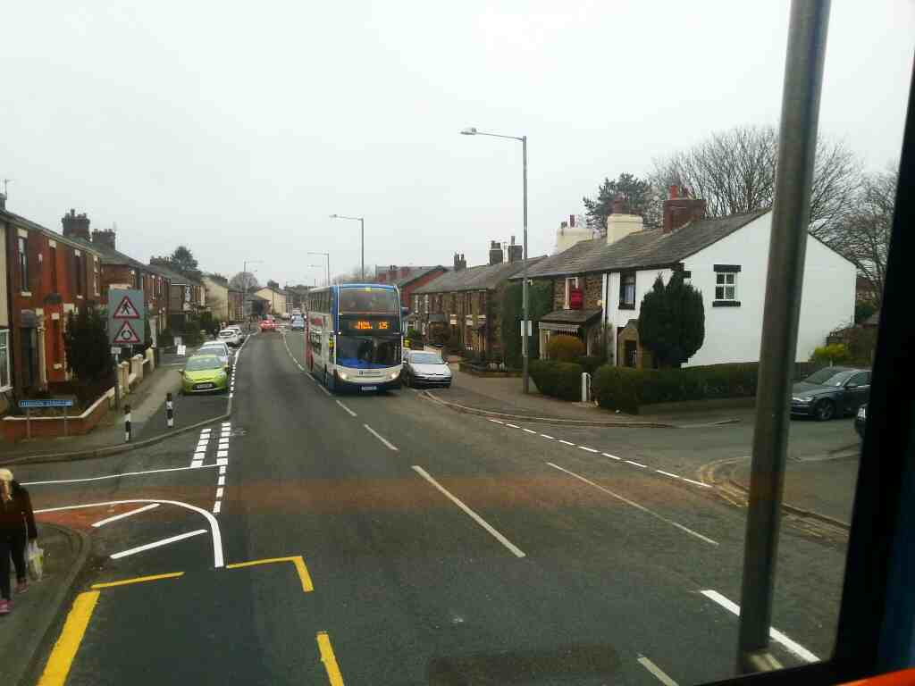 Crossroads of Hodson St and Station Rd off a 125 bus