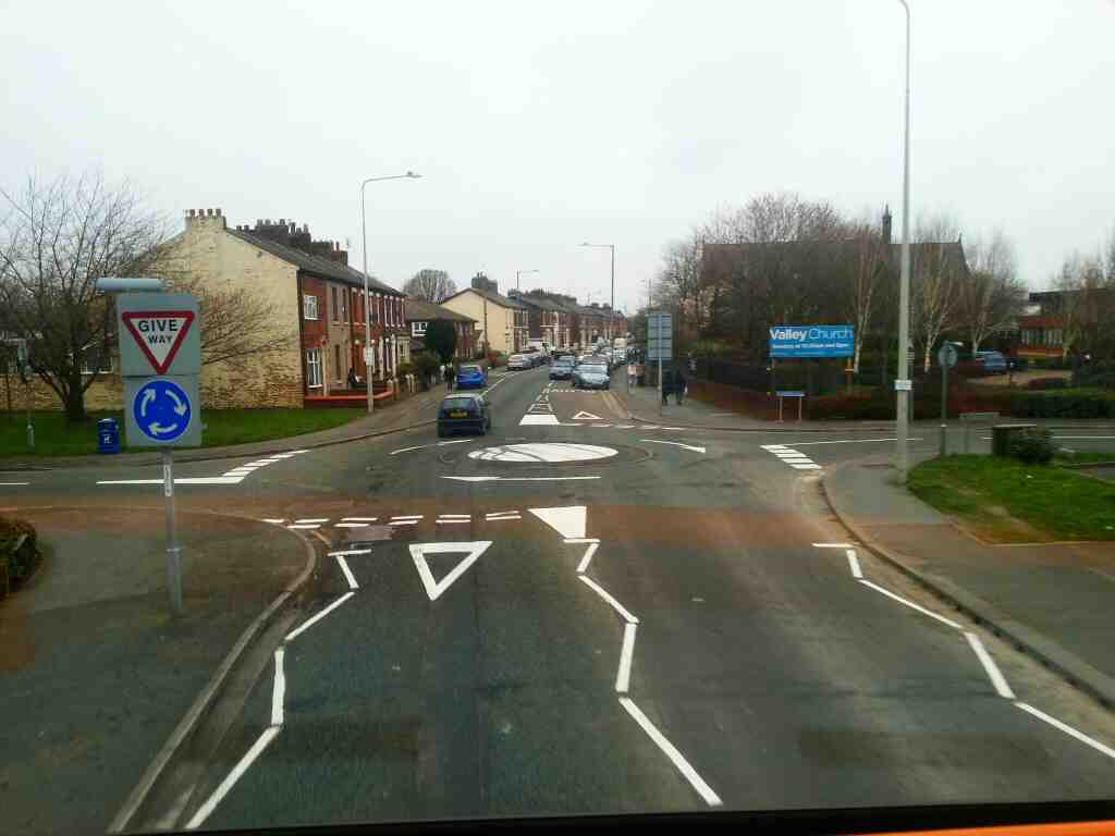 Junction of Longbrook Ave and Fourfields and Station Rd Bamber Bridge on a 125 bus