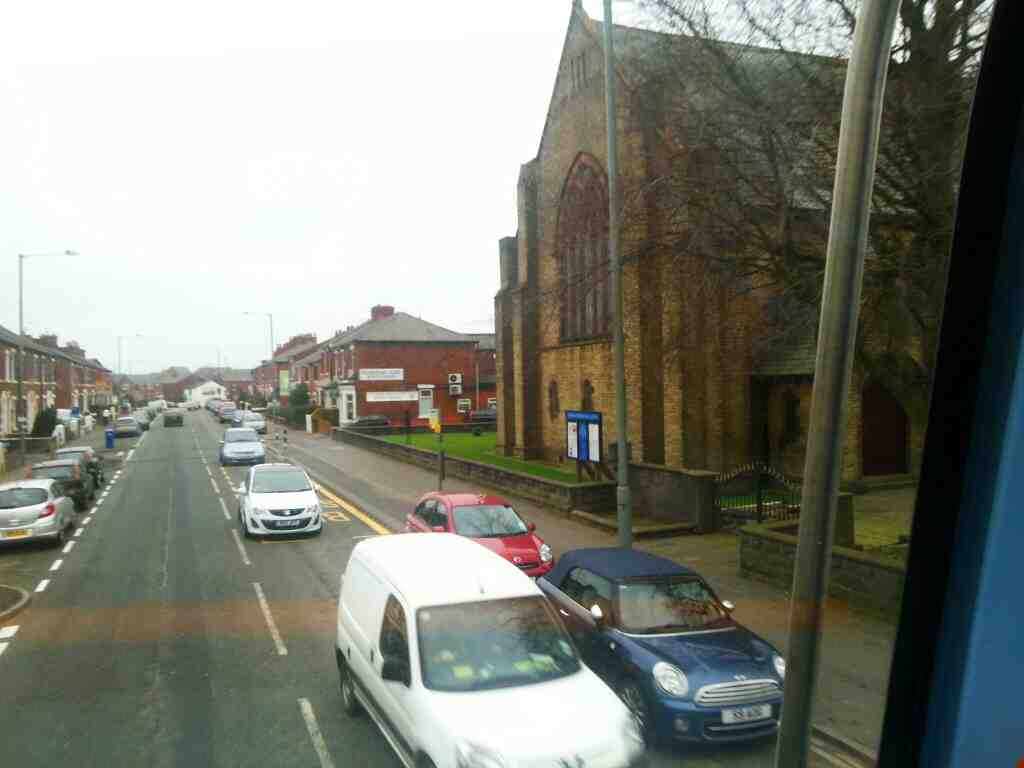 Passes the Parish Church of St Aidan Station Rd Bamber Bridge on a 125 bus