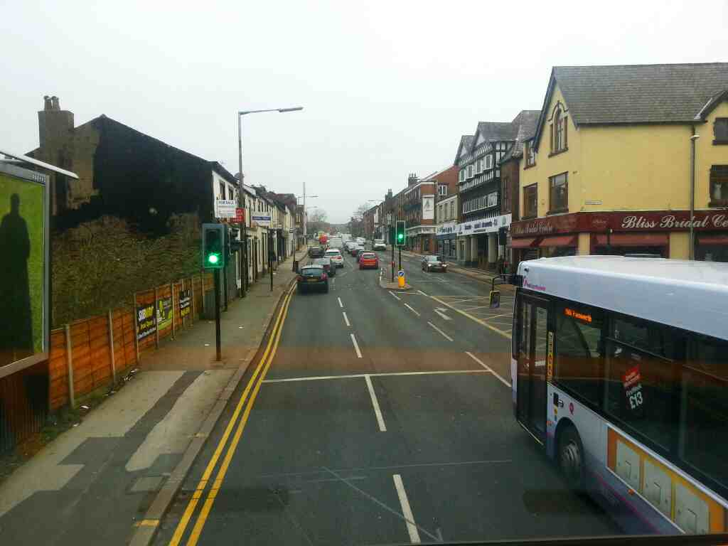 Heading aeay from Bolton Town Center on a Preston bound 125 bus pass Vernon St