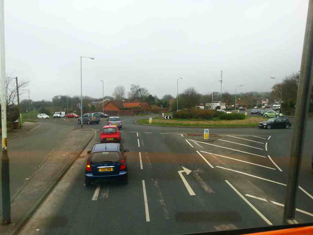 Roundabout Moos Bank Way and Old Chorley Rd cross on a 125 bus