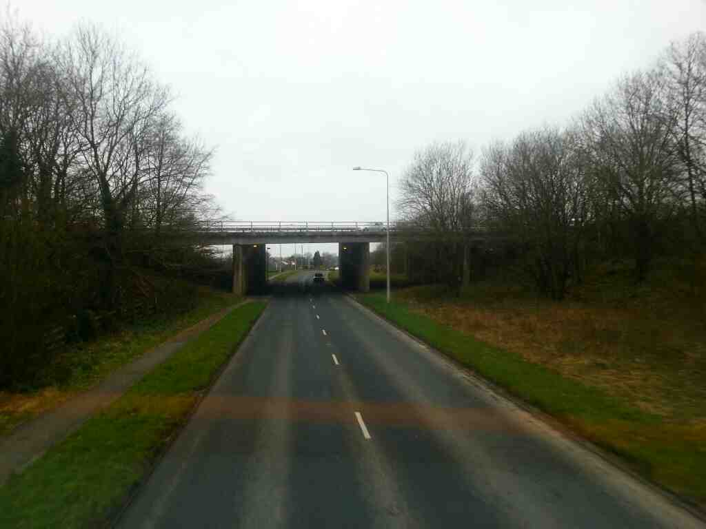 Crossing under the M61 motorway on Bolton Rd the A673 on a 125 bus