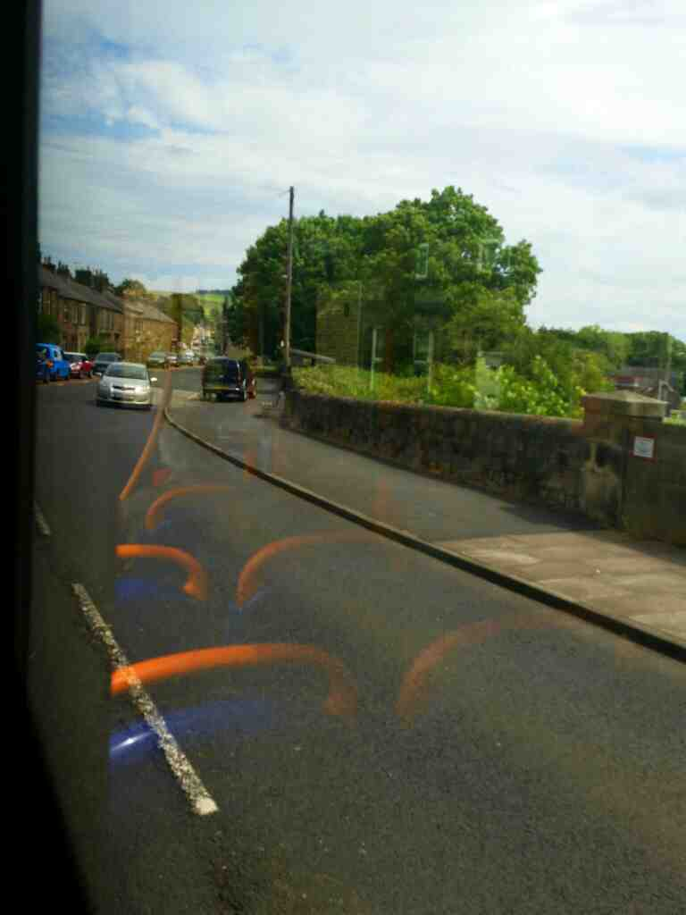 Crossing the Newcastle to Carlise railway on West Rd Haltwhistle on a 685 Carlisle Newcastle bus