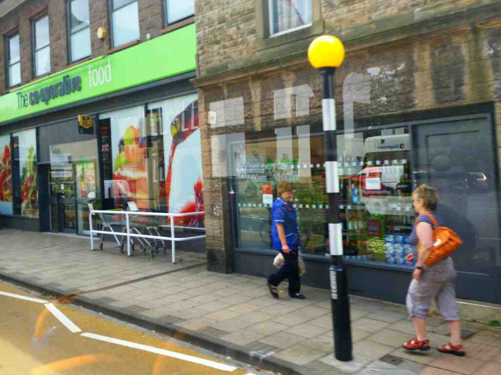 Passes Haltwhistle Co op Westgate on a 685 Carlisle Newcastle bus