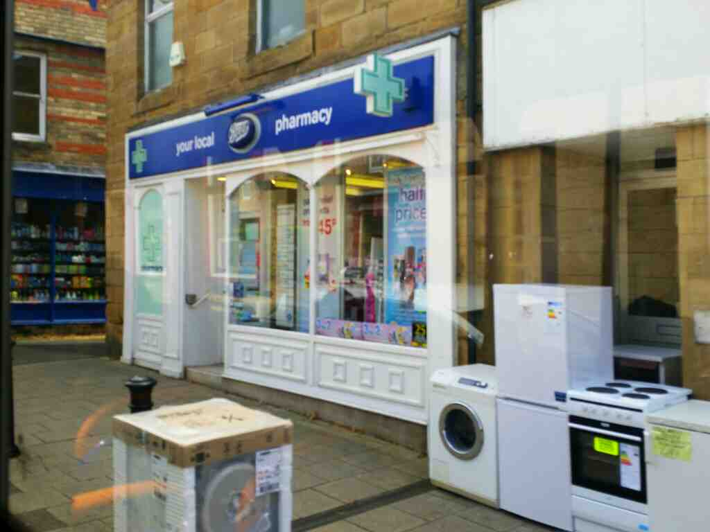 Passes Boots Pharmacy Westgate Haltwhistle on a 685 Carlisle Newcastle bus