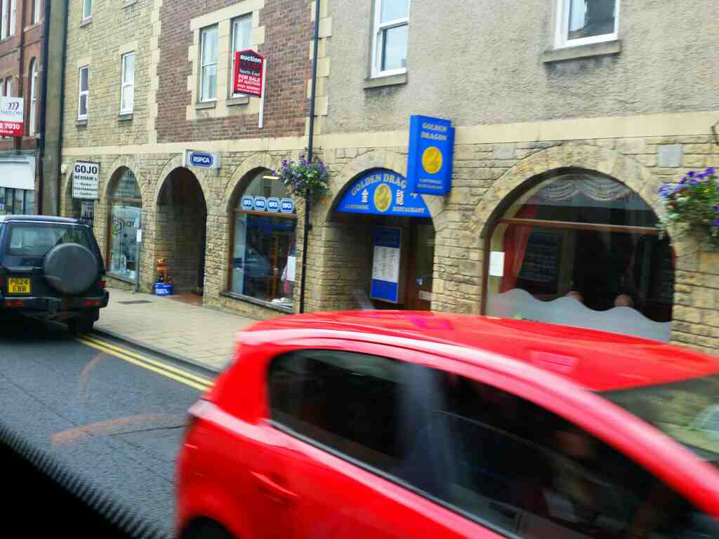 Passes Golden Dragon Chinese Restaurant Battle Hill Hexham on a 685 Carlisle Newcastle bus