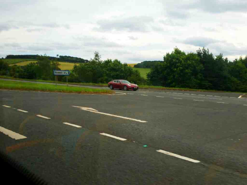 Junction of the A69 and an unamed road signed Bywell on a 685 Carlisle Newcastle bus