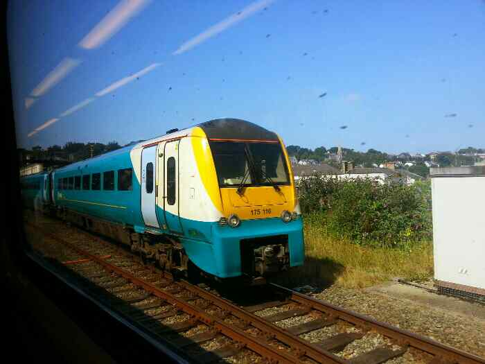 Train leaving Bangor for Manchester Piccadilly