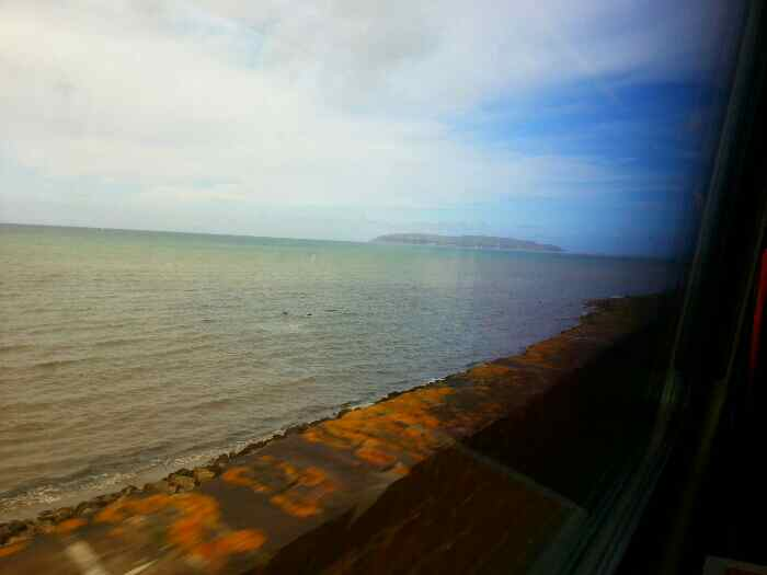 Great on from a train passing round the Pen-y-Clip headland