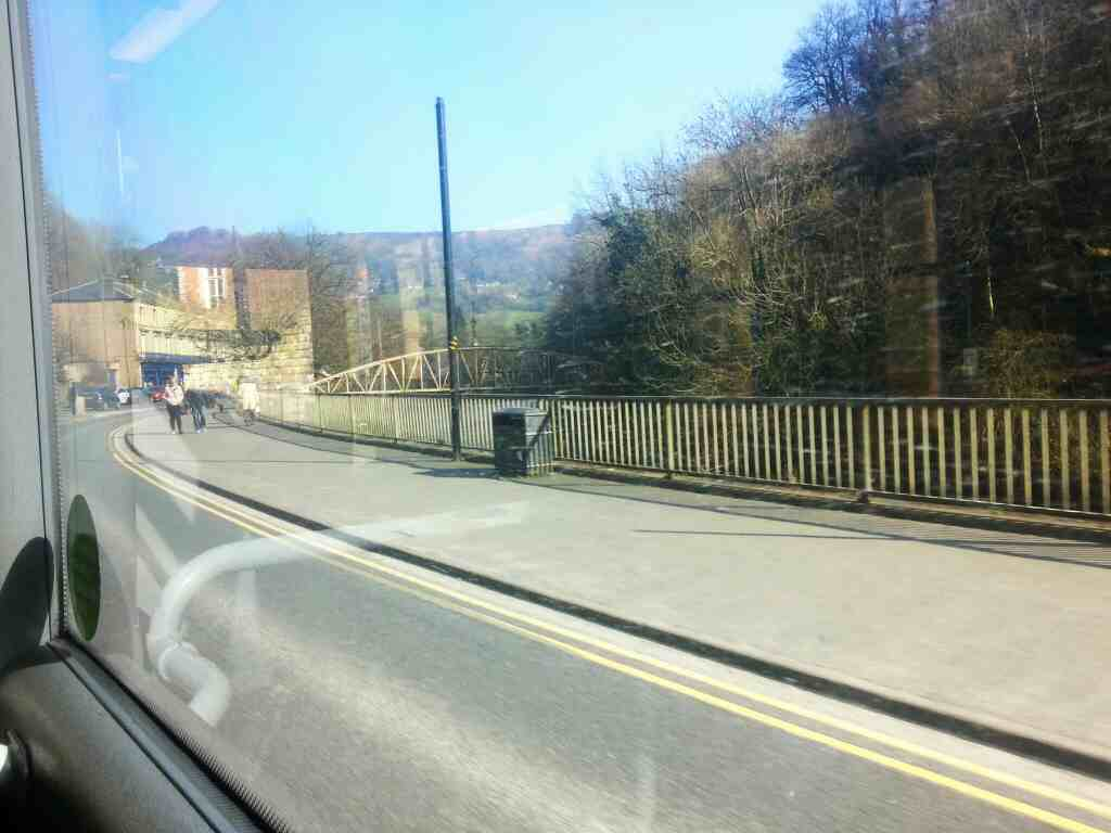 Footbridge across the Derwent from North Parade to the park Matlock Bath from a Transpeak Bus