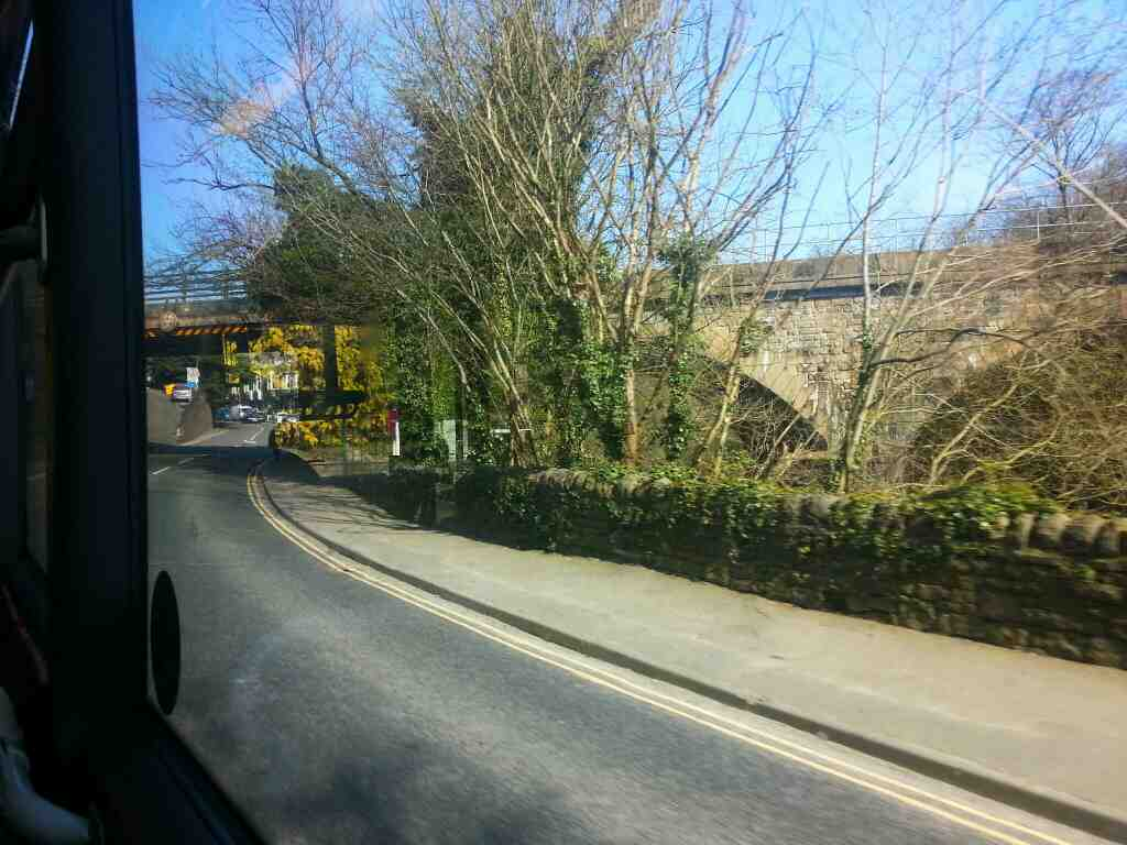 Approaching Matlock on Dale Rd the A6 about to pass under the Derby to Matlock Railway on a Transpeak bus