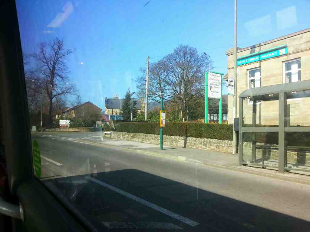 Passes the Jayne Hibbard Pharmacy Dale Rd the A6 Darley Dale on a Transpeak bus
