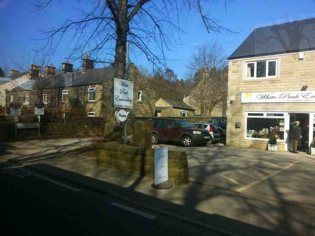 Passes White Peak Embroidery and Tea rooms Dale Rd North Darley Dale on a Transpeak bus