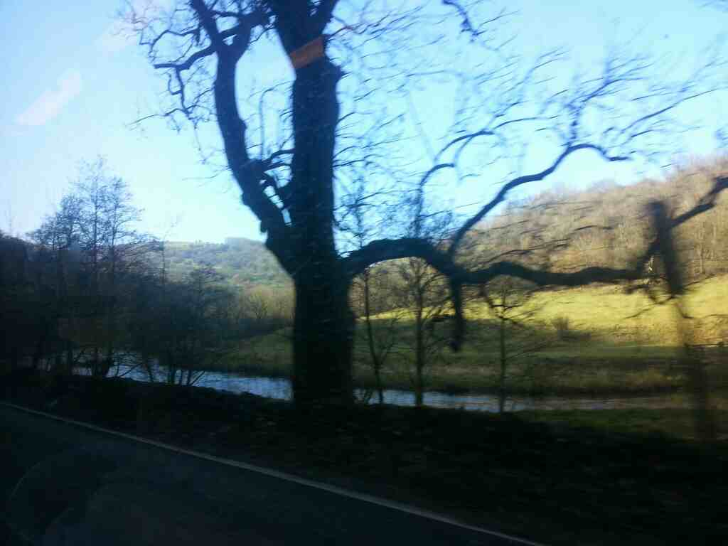 The River Wye Taddington Dale from the A6 off a Transpeak bus