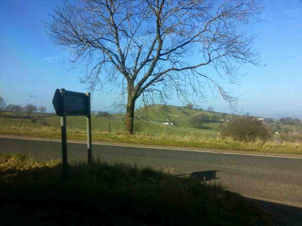 Junction of Main Road and A6 Taddington on a Transpeak bus