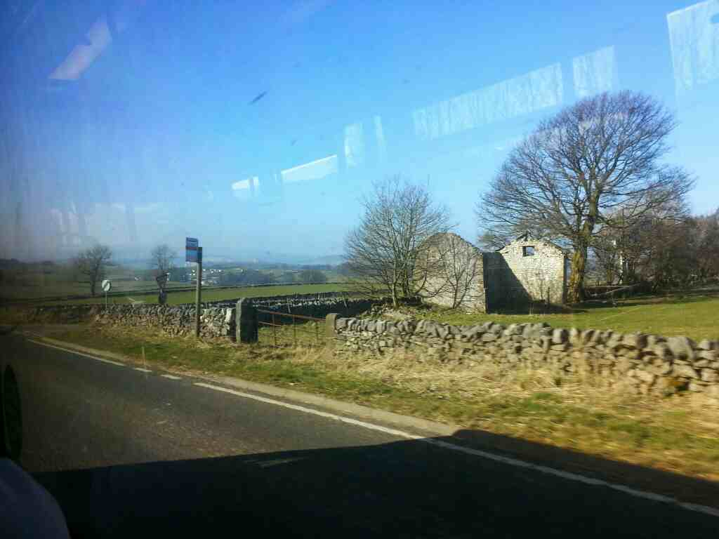 The A6 North West of Taddington on a Transpeak bus