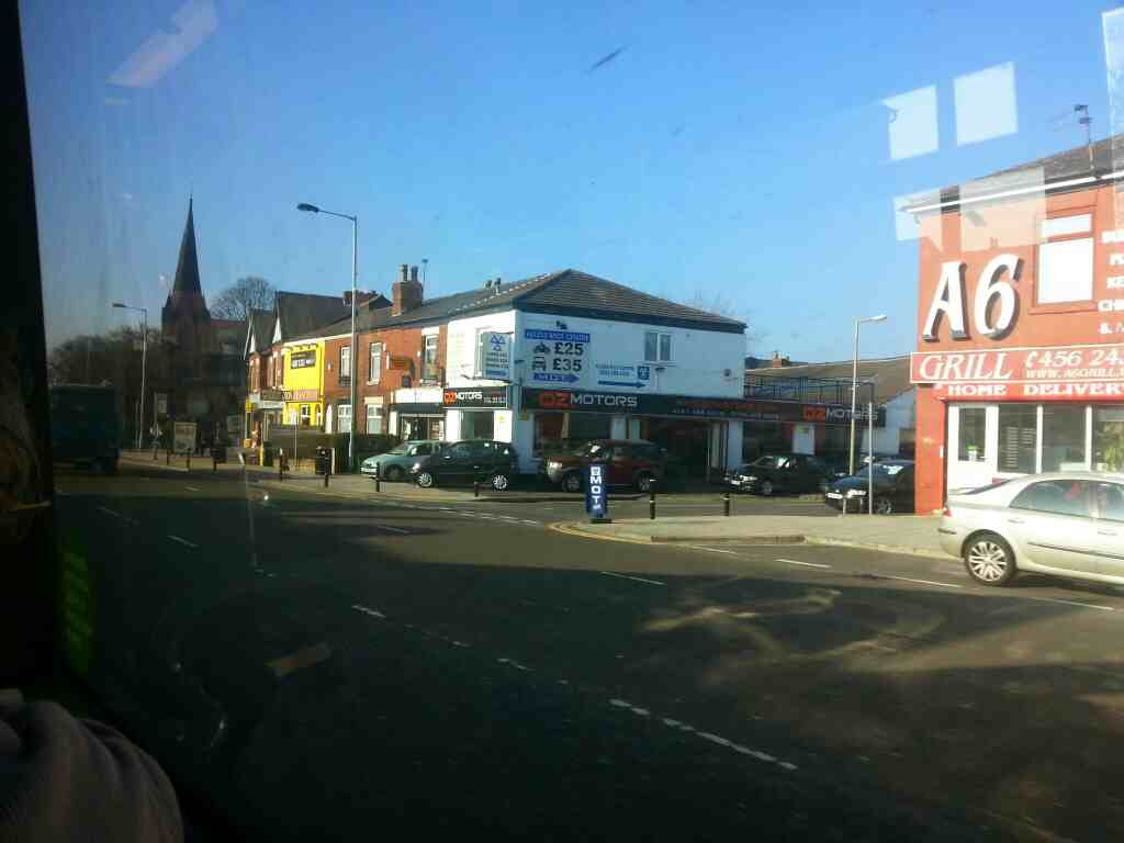 Junction of Aldis St and Buxton Rd the A6 Great Moor and Woodsmoor area of Stockport off a Transpeak bus