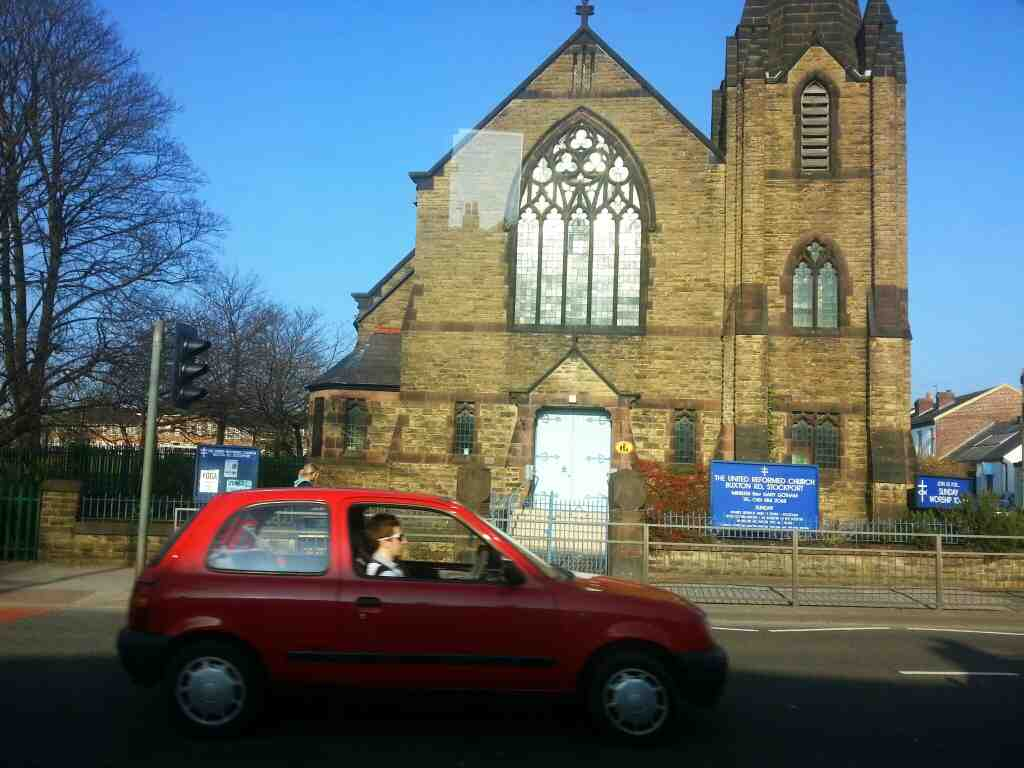 Passes the united reform church Buxton Rd Stockport on a Transpeak bus
