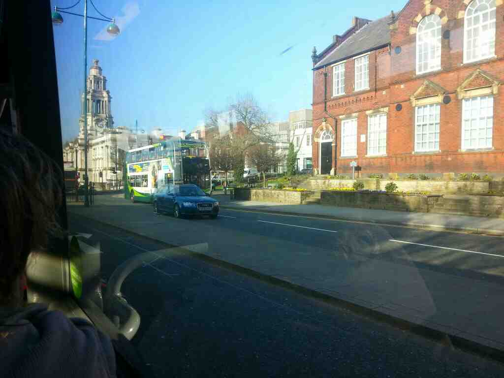A 192 bus passing Stockport Town Hall Wellington Rd South off a Transpeak bus