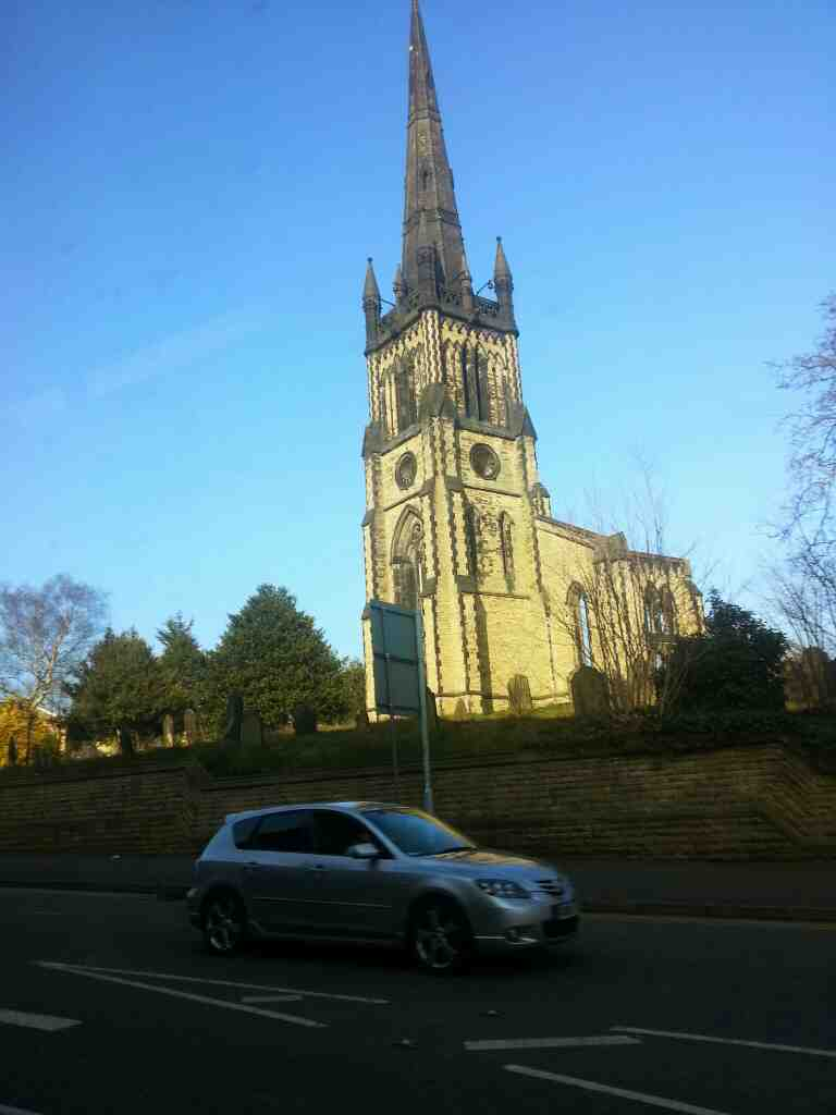 Passes the now Dissused Christ Church Heaton Norris Wellington Rd North on a Transpeak bus