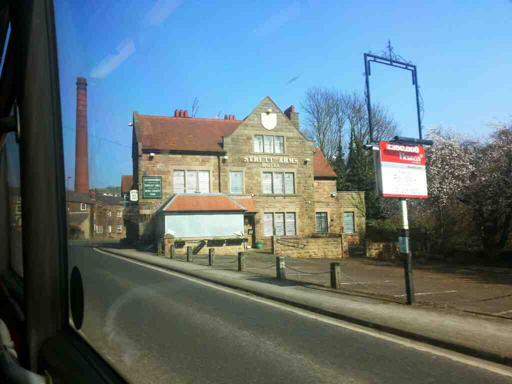 The Derelict Strutt Arms Hotel Milford Derby Road the A6 off a Transpeak bus