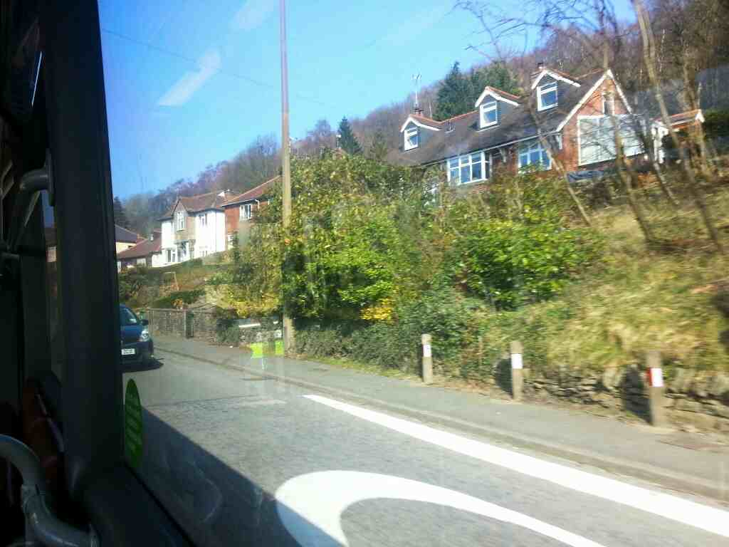 Entering Ambergate on Derby Rd the A6 on a Transpeak bus