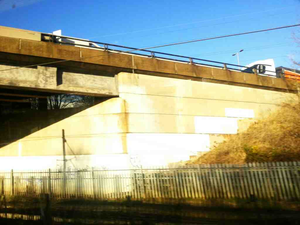 Crossing under the M62 Motorway north of Outwood on a Northern Rail Doncaster to Leeds train