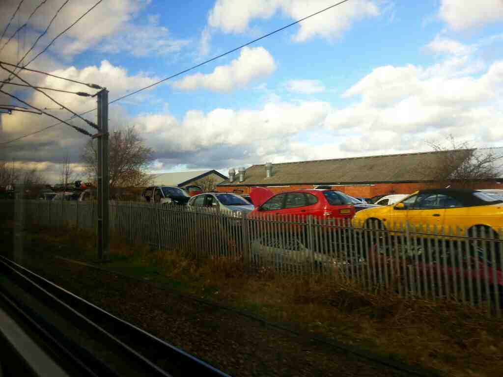 Passes K&S Motor Spares Ltd Scrapyard Adwick Le Street on a Doncaster to Leads train