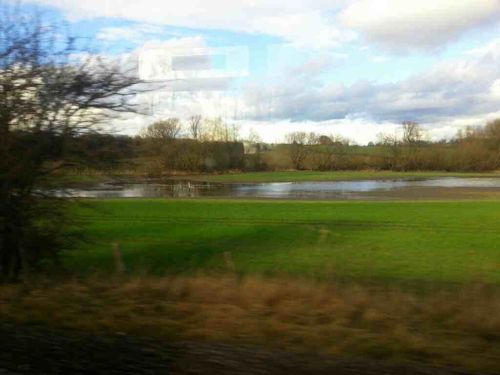 Flooded fields by Frickley Beck off a Doncaster to Leeds train