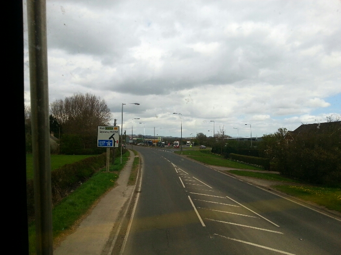 Main Rd approaching its junction with the A63