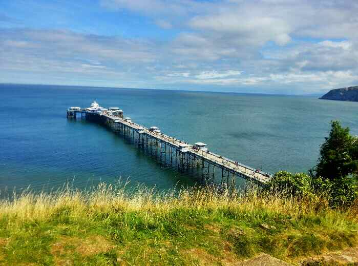 view of Llandudno pier North Wales from Happy Valley