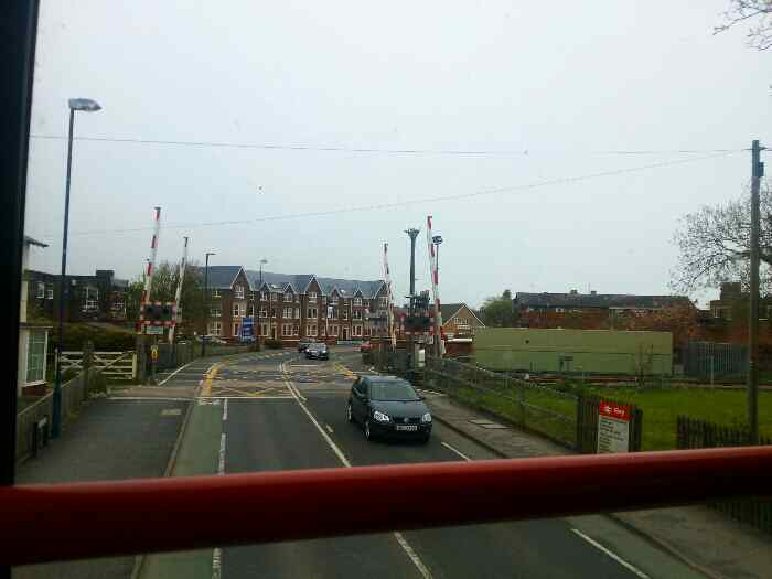 Crossing the Main Hull to Scarborough railway on Muston Rd Filey