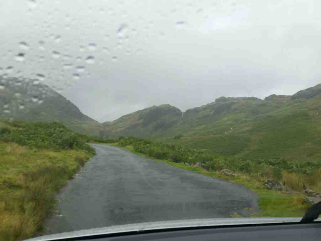 In a car on Britain's steepest road on a car ride over the Hardknott Pass and Wrynose Pass Cumbria
