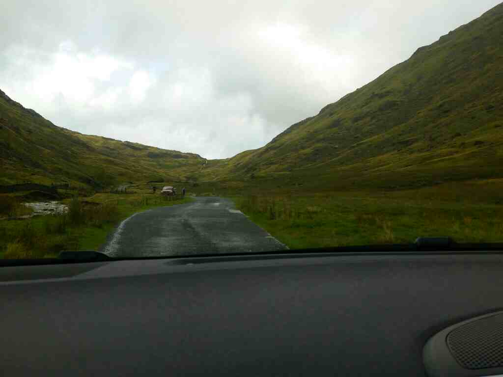 Starting to climb the Wrynose Pass Lake District on a car ride over the Hardknott Pass and Wrynose Pass Cumbria