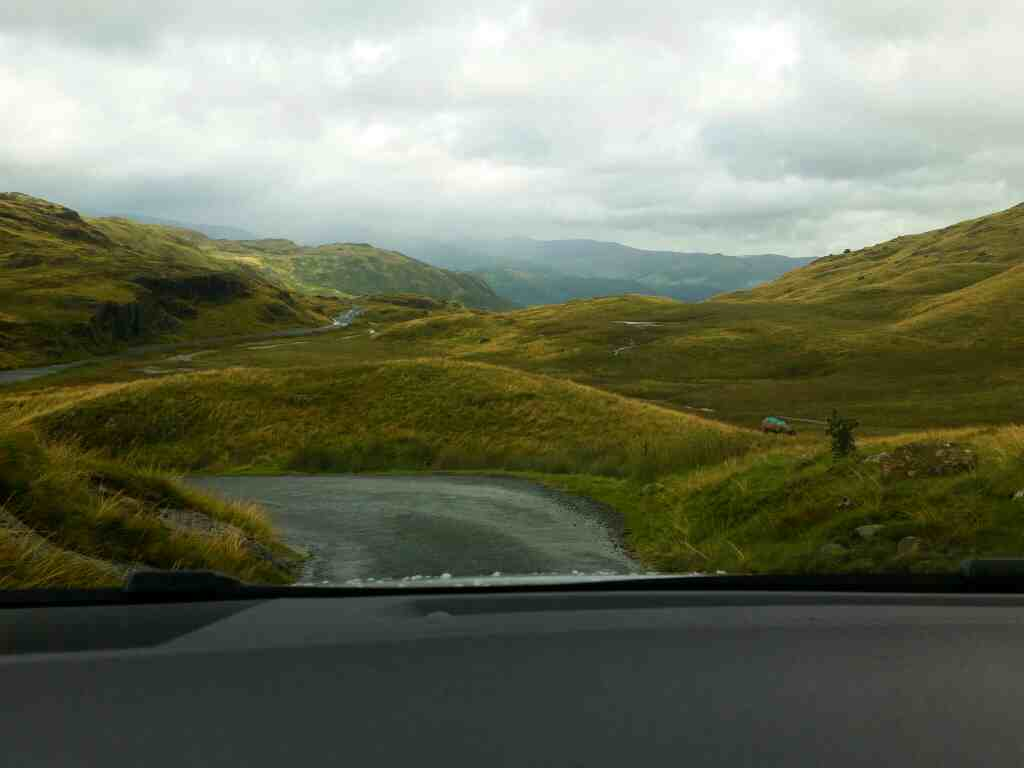On the summit of the Wrynose pass on a car ride over the Hardknott Pass and Wrynose Pass Cumbria