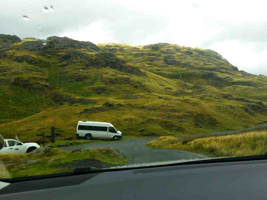 Heading down the eastern side of the Wrynose Pass on a car ride over the Hardknott Pass and Wrynose Pass Cumbria