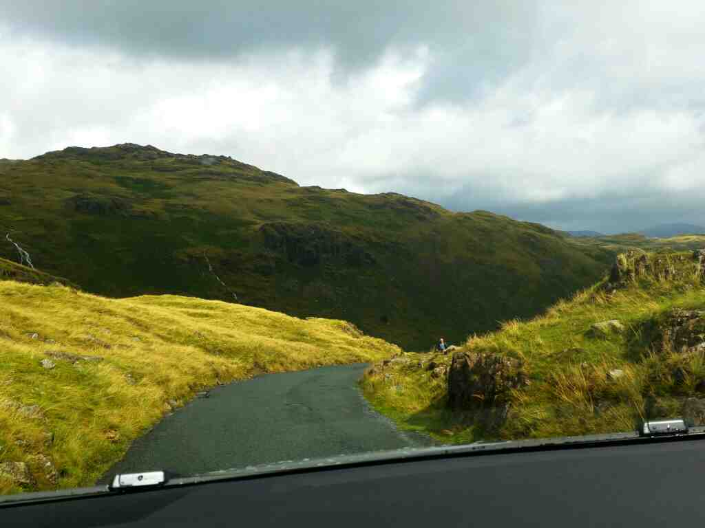 Dropping down into a big gorge on the Wrynose Pass on a car ride over the Hardknott Pass and Wrynose Pass Cumbria