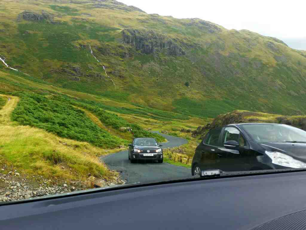 Cars coming up the Wrynose Pass on a car ride over the Hardknott Pass and Wrynose Pass Cumbria