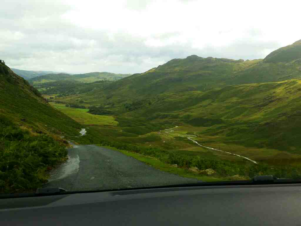 Dropping down into Little Langdale on a car ride over the Hardknott Pass and Wrynose Pass Cumbria