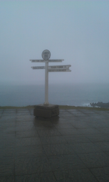The famous sign at lands End showing the distance to New York amongst other places.