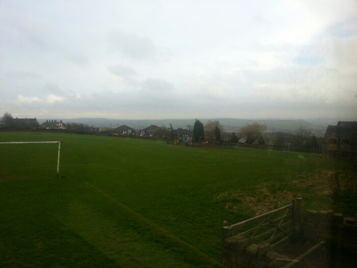 Looking across a playing field at Hartshead