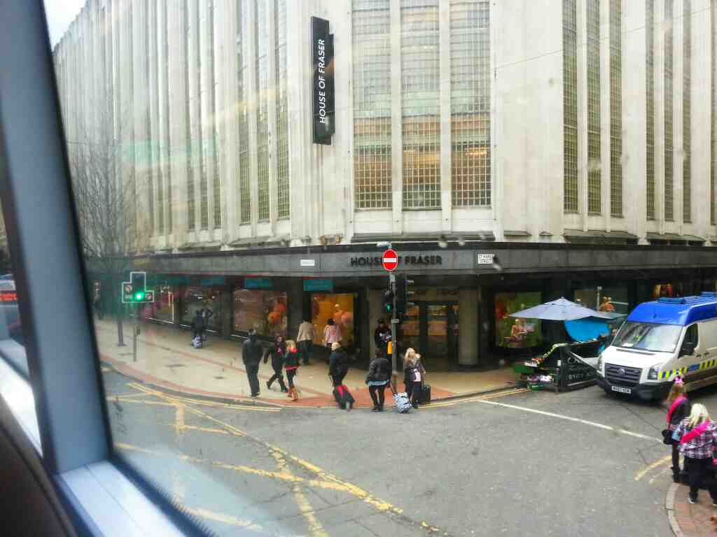 Junction of St Marys Street and Deansgate Manchester House of Fraser on the corner passes on a number 8 bus
