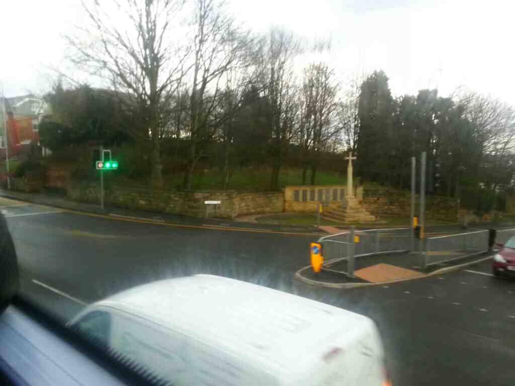 Junction of Bolton Rd and Agecroft Rd with a stone cross off a number 8 bus