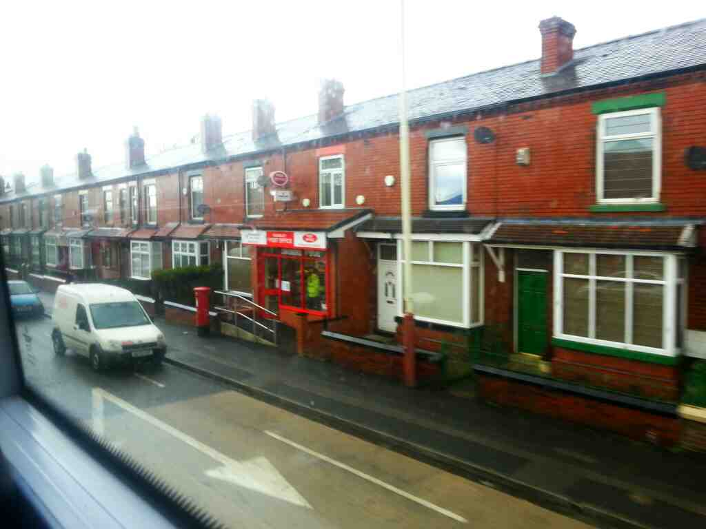 Passes Kearsley Post Office Manchester Rd the A666 on a number 8 bus