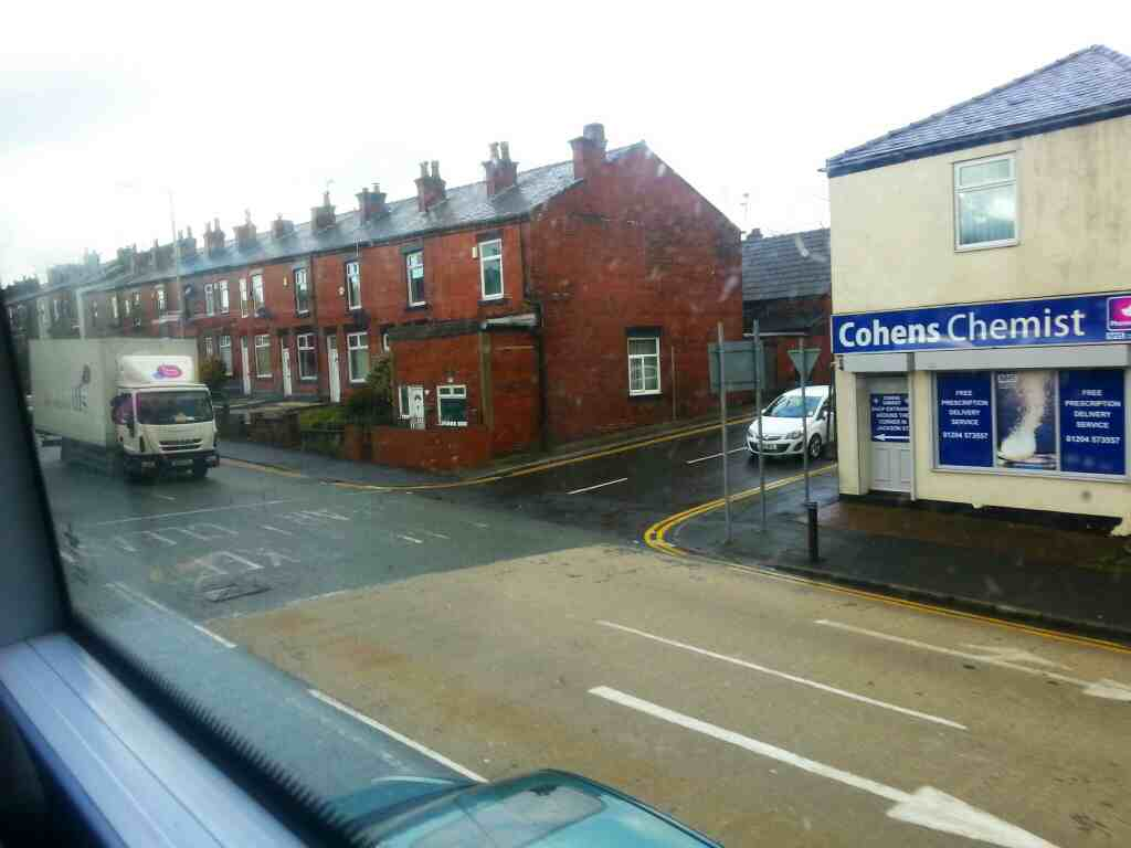 Cohens Chemist at the junction of Jackson St and Bolton Rd the A666 on a Number 8 bus