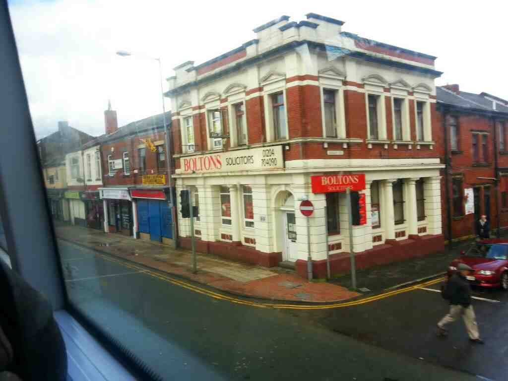 junction of Darley St and Market St Farnworth passes Boltons Solicitors on a number 8 bus